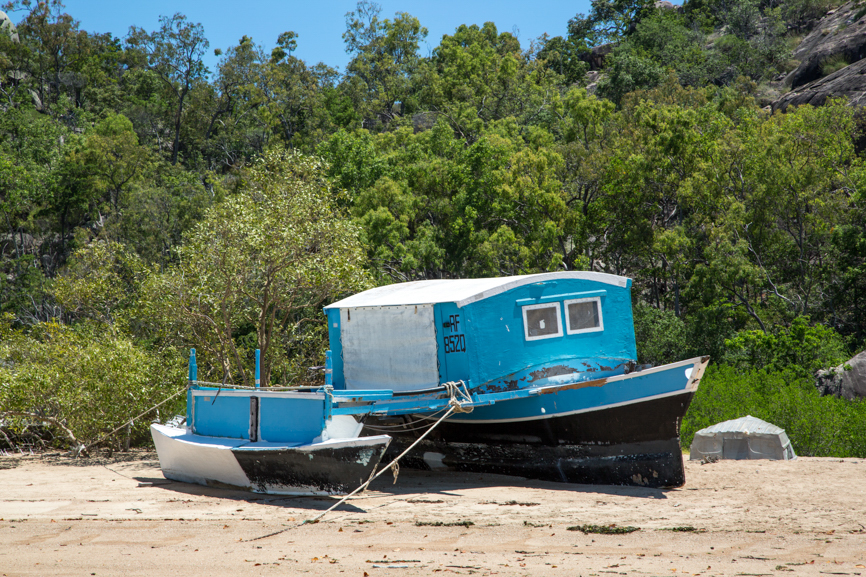 Old blue boat on beach Magnetic Island