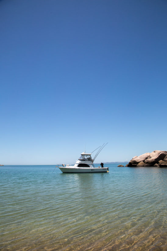Boat in remote bay on Magnetic Island