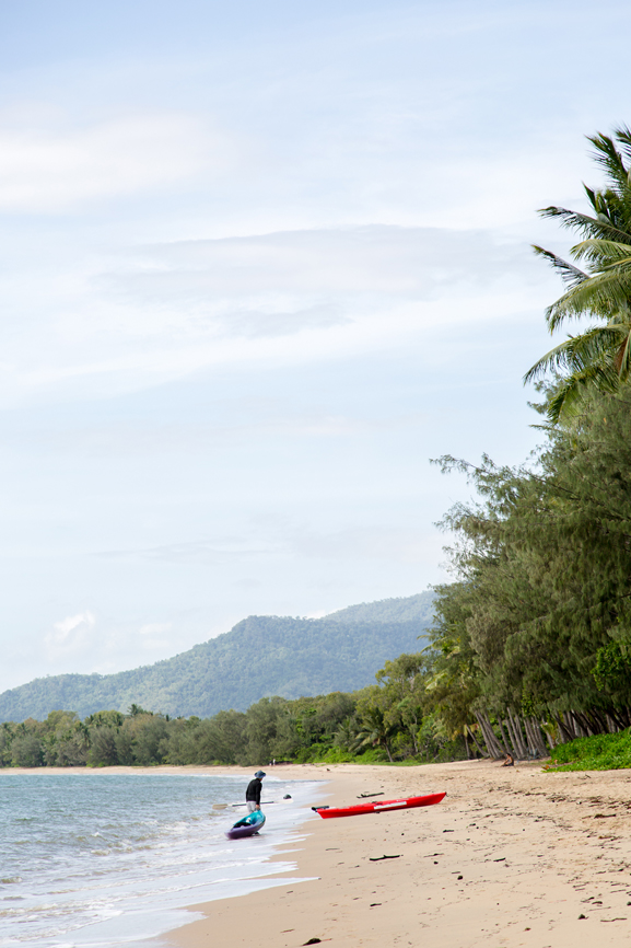 Kayaker on the beach in Palm Cove, Australia