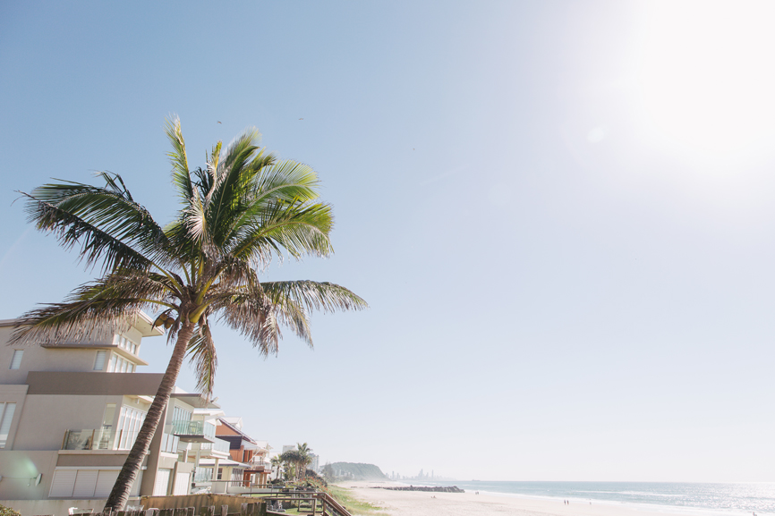 Wide image of beachfront houses in Palm Beach, Queensland, Australia
