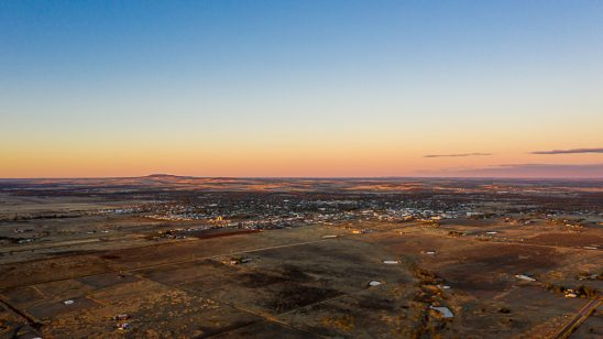 Aerial of outback queensland town at sunset