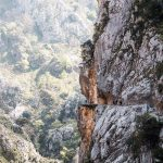 "<span itemprop=""name"">Hikers on cliff edge at Caras Gorge De Europa National Park Northern Spain</span>"